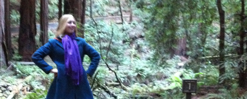Miranda Singler stands in Muir Woods, basking in the glory of the majestic forest.