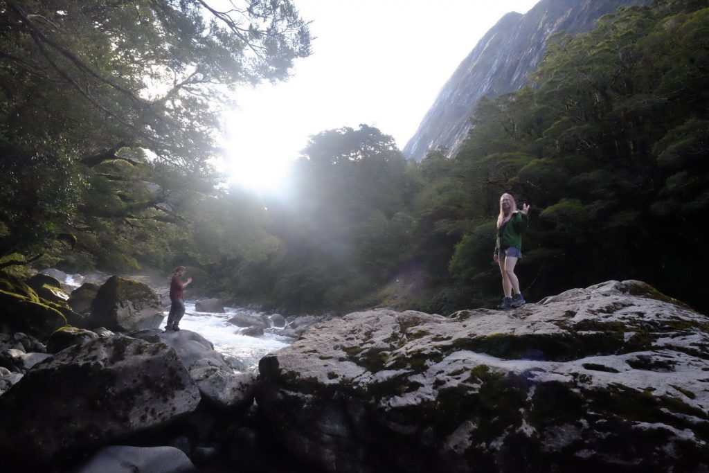 hiking through a rolling river on the road to Milford Sound
