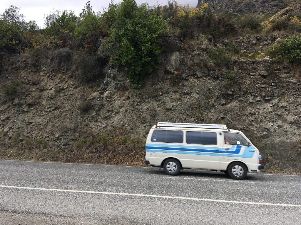van driving on the road toward Queenstown in New Zealand